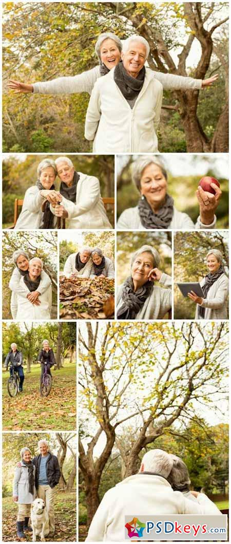 Happy elderly couple in autumn park - Stock photo