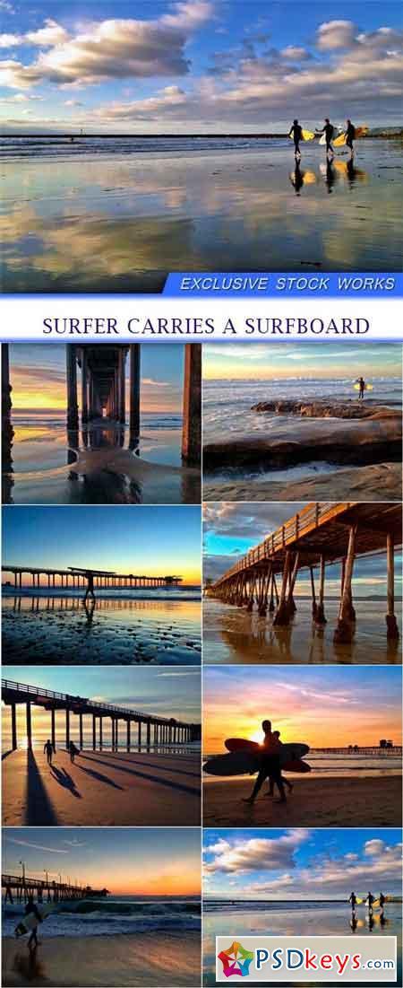 Surfer carries a surfboard 8X JPEG