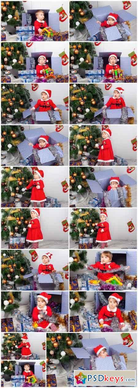 Cute little girl in Santa's suit near a Christmas tree - 19xUHQ JPEG Photo Stock