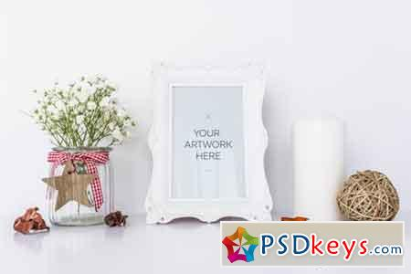 White Frame Mockup With Candle & Flowers