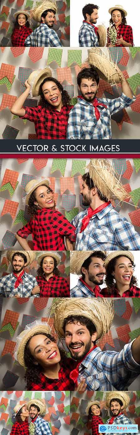Fiesta festive loving couple in suit and straw hat