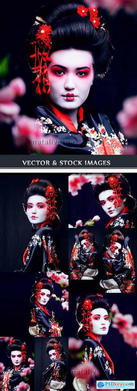 Geisha east beautiful girl in Oriental cherry branches
