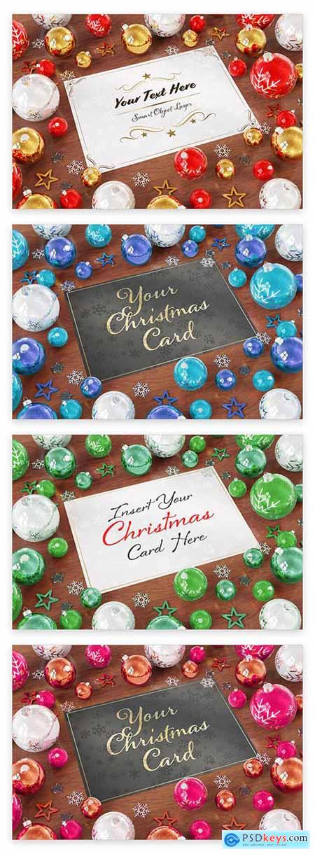 Christmas Card with Ornaments on Wooden Table Mockup 229639892