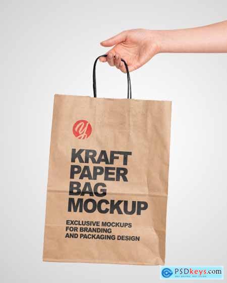 Hand Holding a Paper Bag Mockup 55166