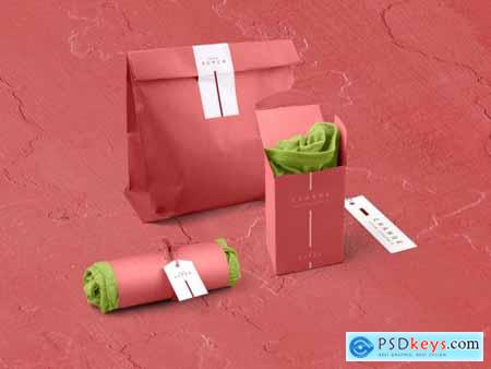 2 Folded T-Shirts with Paper Bag in Rose Red Colors Mockup 319878283