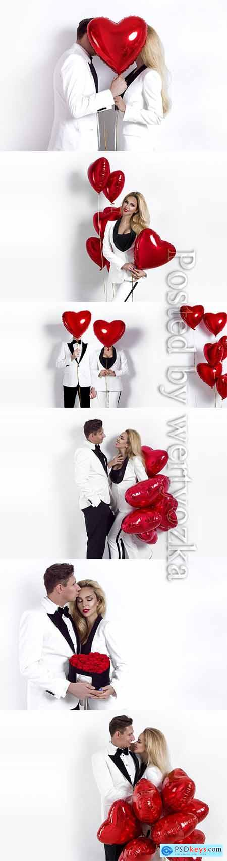 Loving couple with balloons from hearts