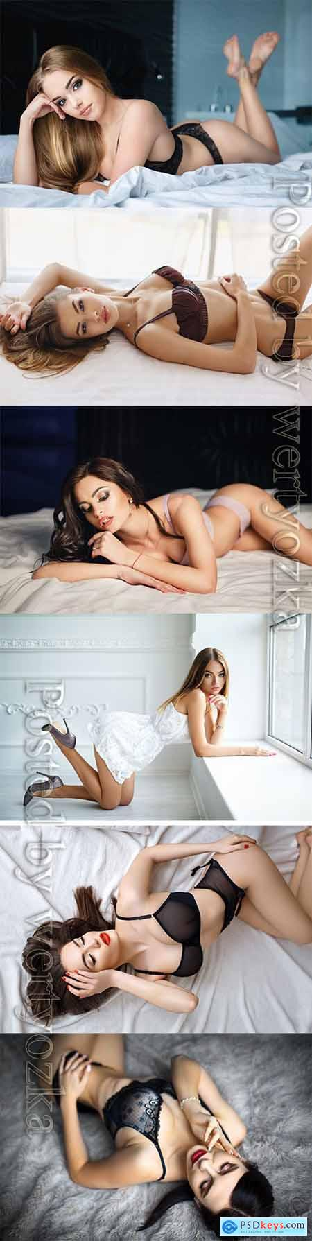 Sexy girls posing on the bed