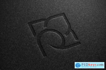 Realistic mockup of logo on black fabric