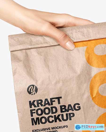 Kraft Food Bag in a Hand Mockup 67808