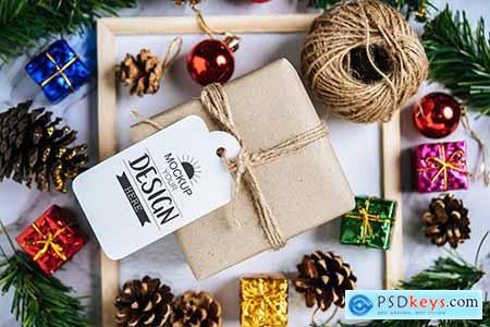 Mockup Christmas gift with decorations and spruce cones