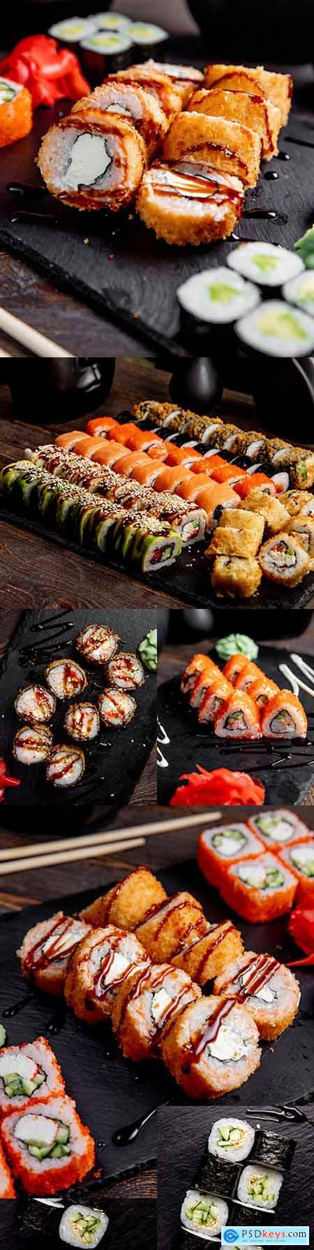 Sushi and rolls with sauce on the table Japanese cuisine