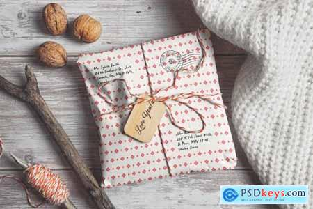Parcel Wrapped In Paper With Wooden Tag Mockup