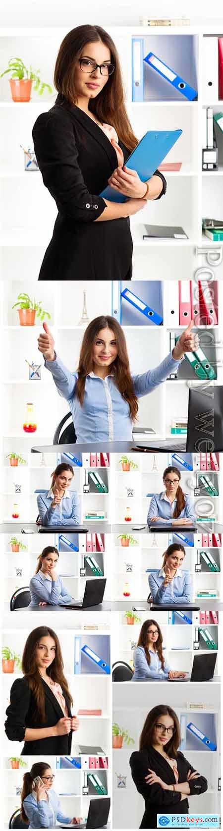 Girl working in the office in various positions stock photo