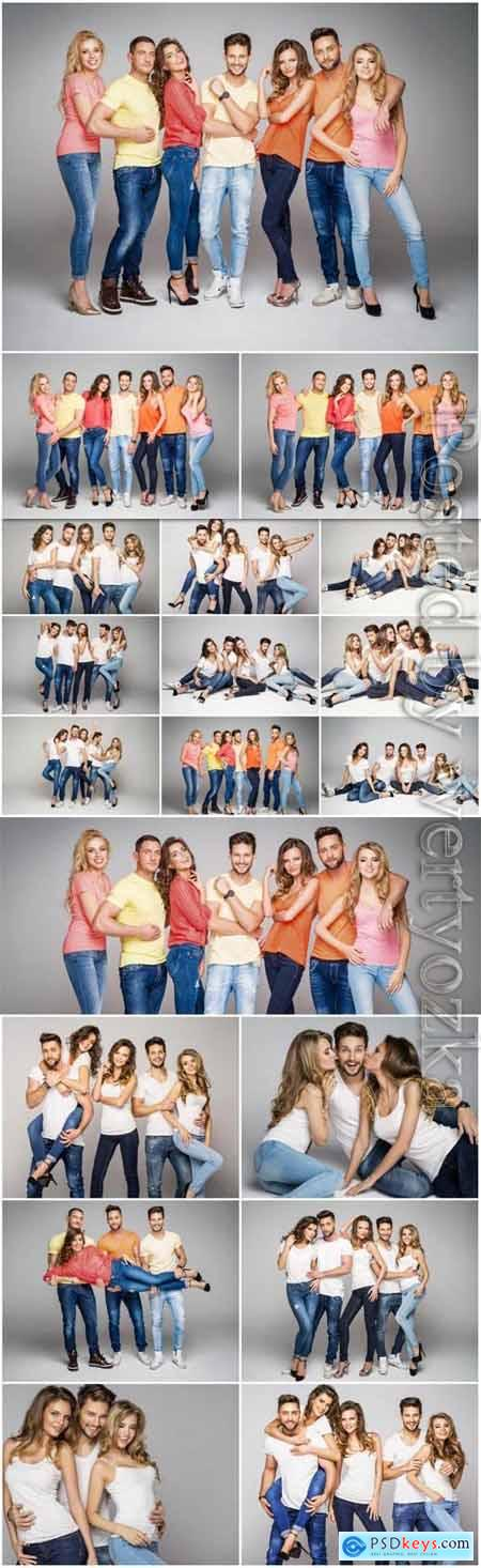 Stylish men and girls in jeans stock photo