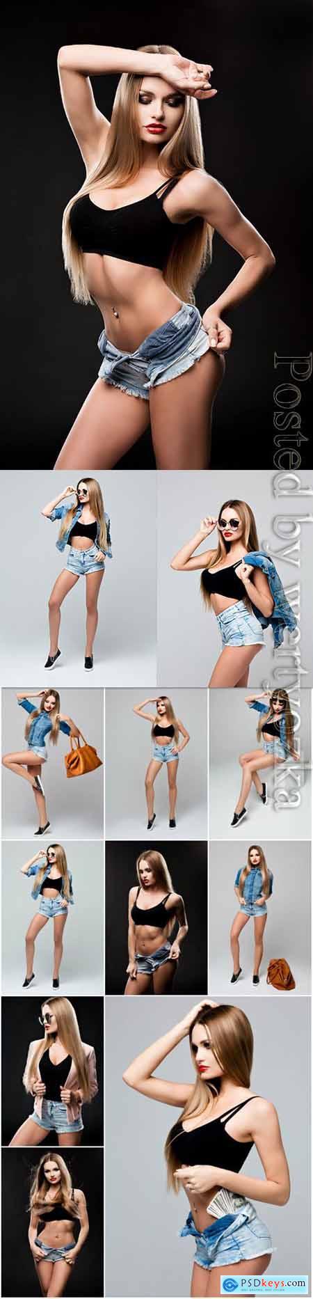 Girl in denim shorts stock photo