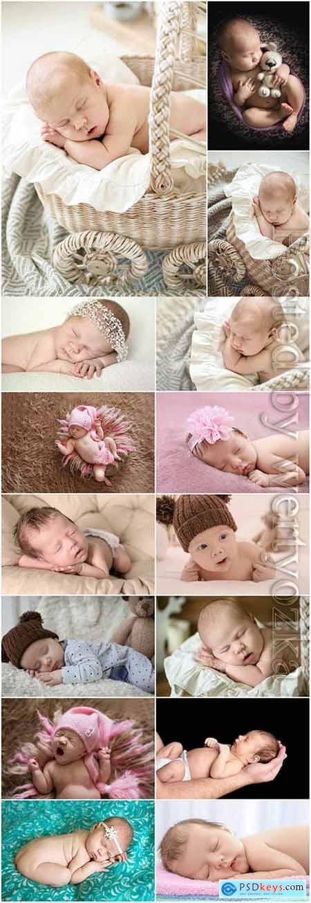 Adorable newborn babies at a photo shoot stock photo