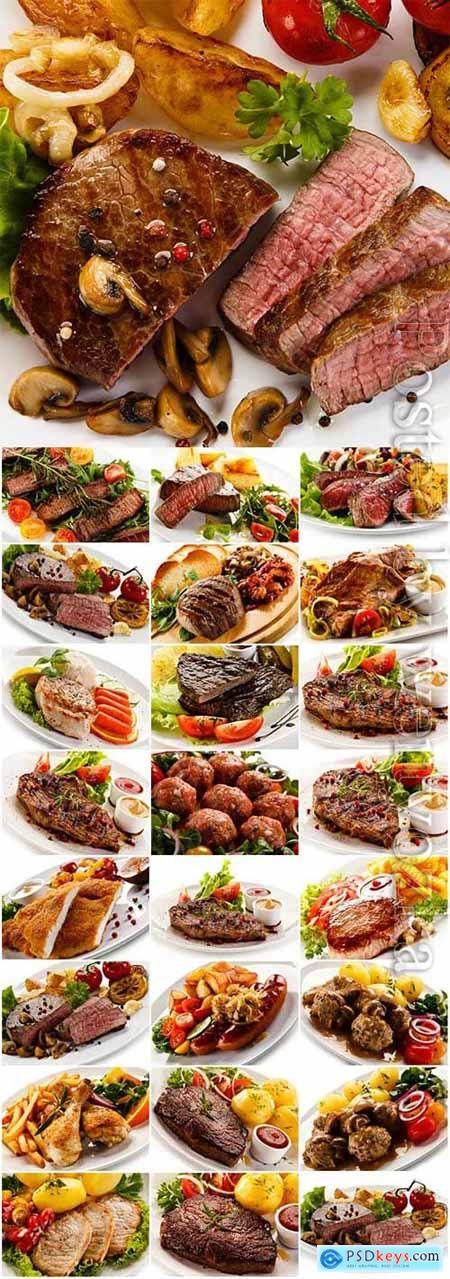 Meat dishes with garnish on white background stock photo