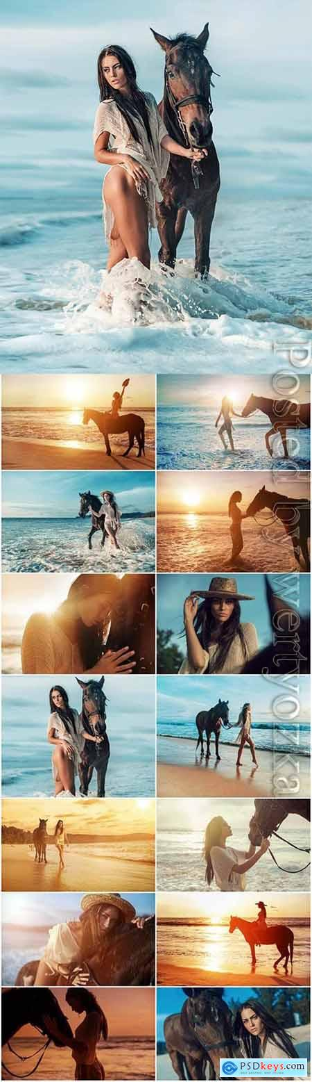 Girl with horse on the sea stock photo